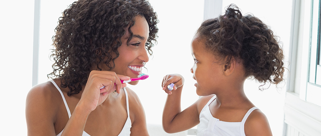 Mother and daughter with pretty smiles because of dental insurance