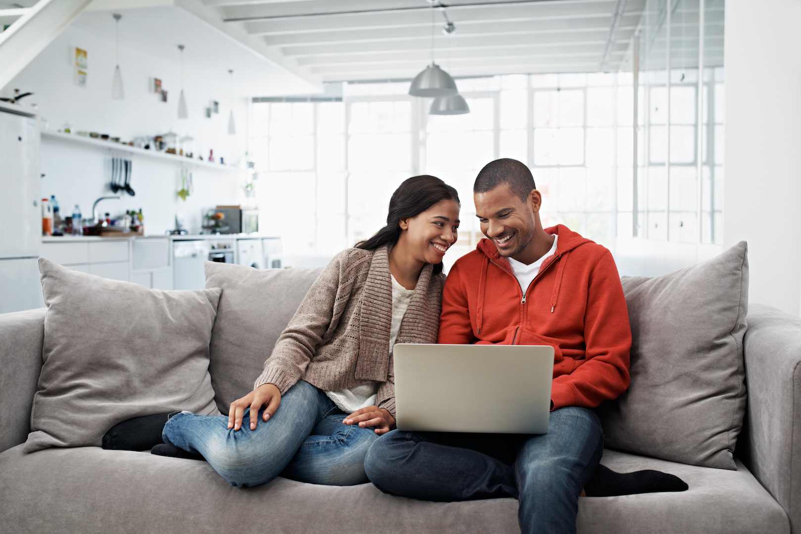 Senior couple on their laptop using online banking safety tips