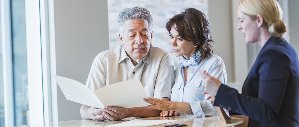 A couple consults with a financial advisor that they know they can trust