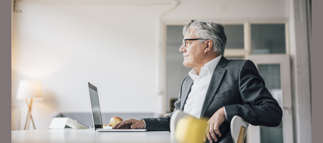 Man learning about medicare eligibility on laptop